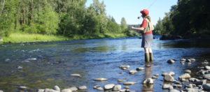 girl trout fishing